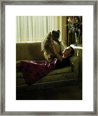 A Model Holding A Dog Framed Print by Constantin Joffe