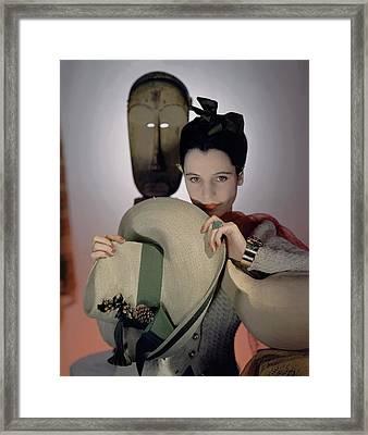 A Model Holding A Sun Hat Framed Print by Horst P. Horst