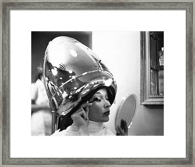 A Model In A Beauty Salon Framed Print by Constantin Joffe