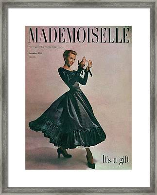 A Model In A Dress By Motley Of London Framed Print by Gene Fenn