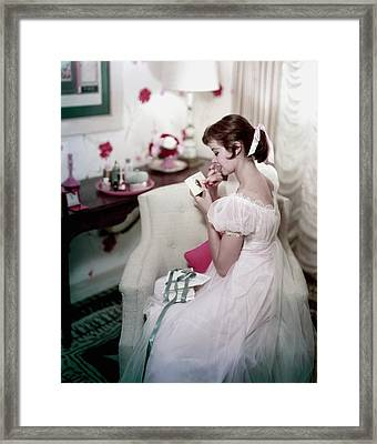 A Model In A Gown Sitting On An Armchair Framed Print by Sante Forlano