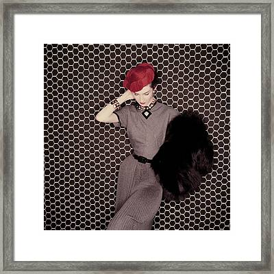 A Model In A Grey Dress And Red Hat Framed Print