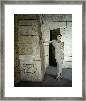 A Model In A Omar Kiam Dress Framed Print by John Rawlings