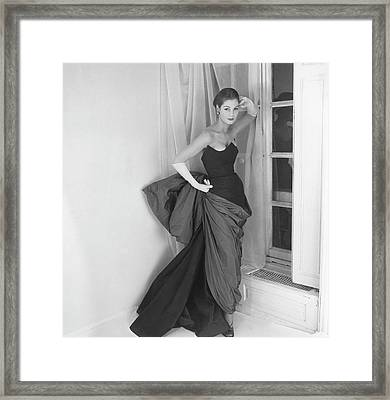 A Model In A Schiaparelli Dress Framed Print by Henry Clarke