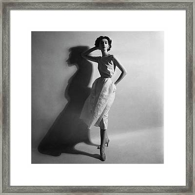 A Model In A Sheath Dress Framed Print by Cecil Beaton