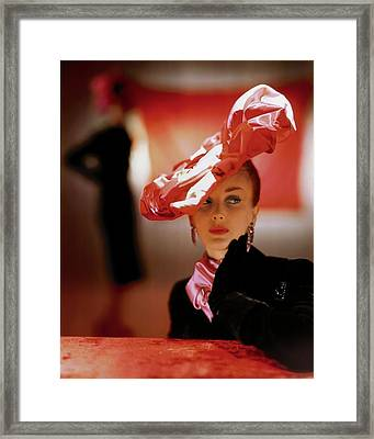 A Model In A Suzanne Et Roger Hat Framed Print by John Rawlings