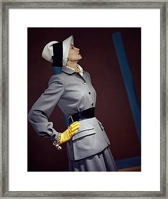 A Model In A Vogue Couturier Suit Framed Print by Horst P. Horst