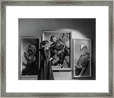 A Model In Front Of Photographs Framed Print by Horst P. Horst