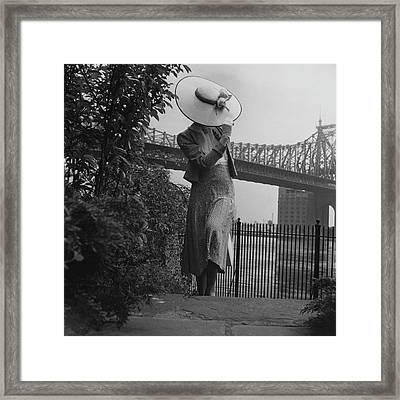 A Model In Front Of The 59th Street Bridge Framed Print