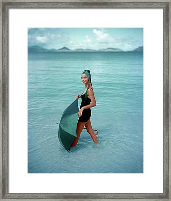 A Model In The Sea With An Umbrella Framed Print