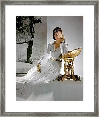 A Model Leaning On A Gold Pedestal Framed Print