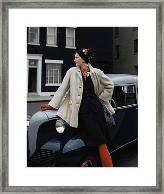A Model Leaning On A Vintage Car Framed Print by John Rawlings