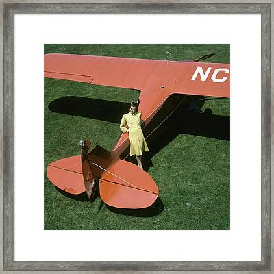 A Model Leaning On An Airplane Framed Print