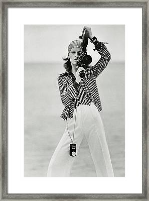 A Model Looking Through A Beaulieu Camera Wearing Framed Print by Gianni Penati
