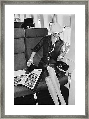 A Model Looks Wearing Abe Schrader On An Airplane Framed Print