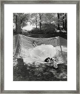 A Model Lying On A Hammock Framed Print by Gene Moore