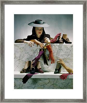 A Model Next To A Shelf Of Assorted Shoes Framed Print by Horst P. Horst