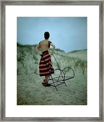 A Model On A Beach Framed Print