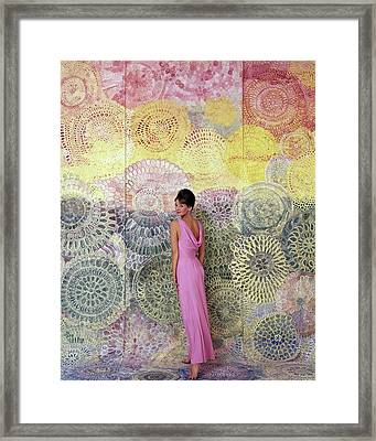 A Model Posing By A Colorful Mural Framed Print