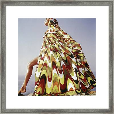 A Model Posing In A Colorful Cover-up Framed Print