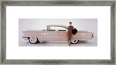 A Model Posing In Front Of A Vintage Car Framed Print