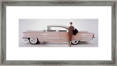 A Model Posing In Front Of A Vintage Car Framed Print by Karen Radkai
