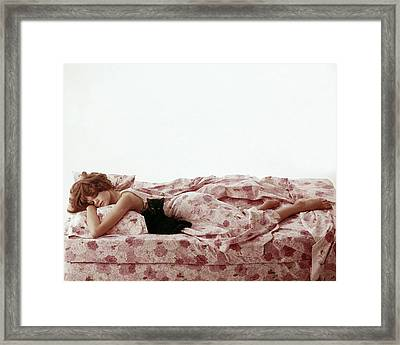 A Model Sleeping On Floral Bed Linens Framed Print