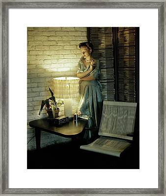 A Model Smoking By Furniture Framed Print