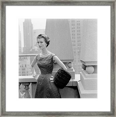 A Model Standing Against A Rooftop Column In An Framed Print
