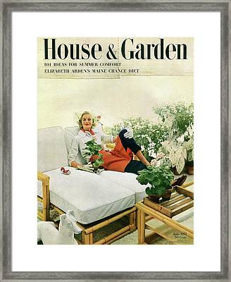 A Model Surrounded By House Plants Framed Print by Richard Rutledge