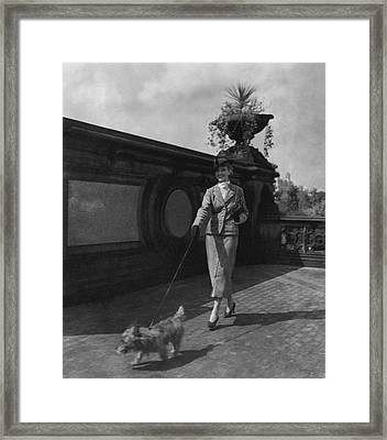 A Model Walking A Dog Framed Print by Remie Lohse