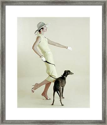 A Model Walking A Dog Framed Print