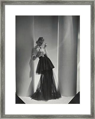 A Model Wearing A 1930s Style Evening Gown Framed Print by Horst P. Horst