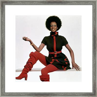 A Model Wearing A Bill Blass Dress Framed Print