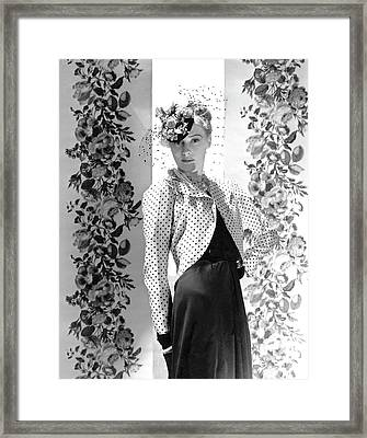 A Model Wearing A Bolero Jacket And Necklaces Framed Print