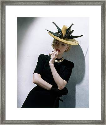 A Model Wearing A Buccaneer Hat Framed Print by Toni Frissell