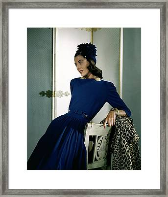 A Model Wearing A Cap And Dress Framed Print