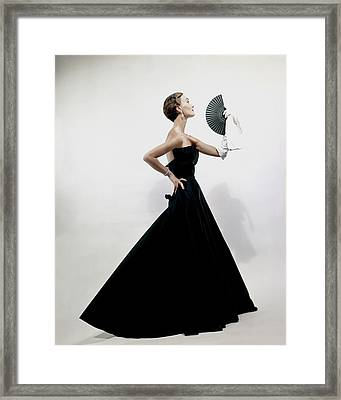 A Model Wearing A Christian Dior Dress Framed Print by Erwin Blumenfeld