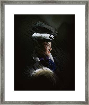 A Model Wearing A Coat And Hat Framed Print