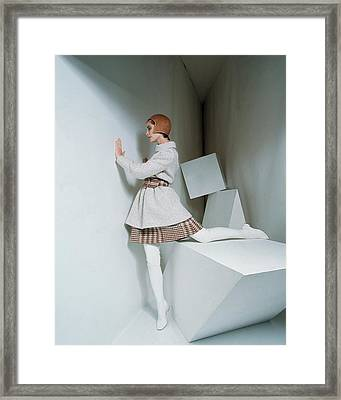A Model Wearing A Coat And Plaid Skirt Framed Print by David Mccabe
