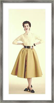 A Model Wearing A Cream Sweater And Camel Skirt Framed Print
