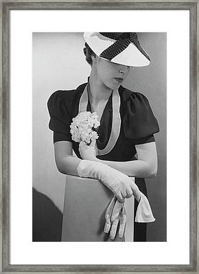 A Model Wearing A Crepe Dress And Straw Hat Framed Print