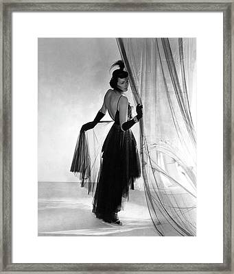 A Model Wearing A Dress And Gloves Framed Print by Horst P. Horst