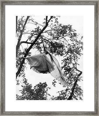 A Model Wearing A Dress In A Tree Framed Print by Gene Moore
