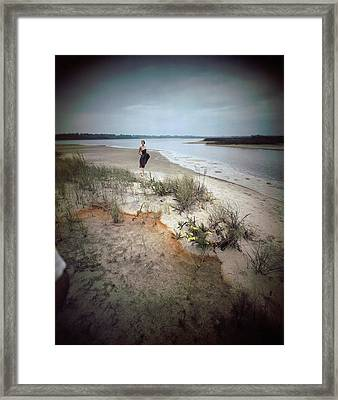 A Model Wearing A Dress On A Beach Framed Print