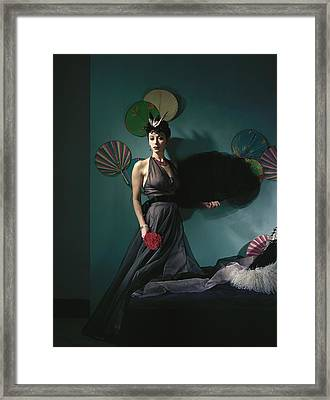 A Model Wearing A Dress With Fans Framed Print by Horst P. Horst