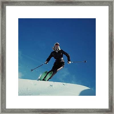 A Model Wearing A Ernst Engel Ski Suit Framed Print