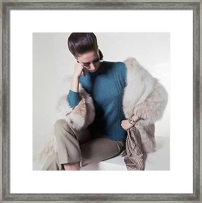 A Model Wearing A Fur Coat Framed Print by Horst P. Horst