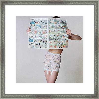 A Model Wearing A Girdle With A Comic Framed Print by Louis Faurer