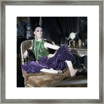A Model Wearing A Glittery Top And Velvet Pants Framed Print